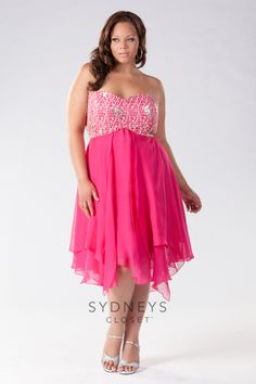 """#Pink is perfect for #Prom and so is #Blue! You can choose either one with our brand new Plus Size """"Emma"""" dress. This stunning short #gown is made of chiffon. The open lace bodice is adorned with scattered sequins that guarantee you'll shine at the big #dance. It has a full skirt with flowing panels and a handkerchief hem. You'll just love this fun #dress available in sizes 14 to 28"""