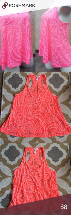 Sheer Cheetah Print Tank! Cute sheer cheetah print tank! The last picture shows the same tank styled but with a different color. The true color of this tank is coral orange. If you have any questions feel free to ask! :) Ambiance Apparel Tops Tank Tops