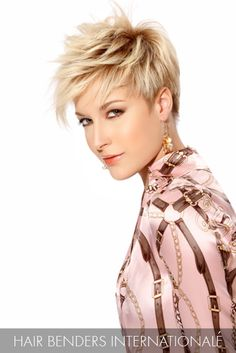 A unique take on the pixie trend features contrasts in color from the roots to the bangs, and razored layers contoured to her face shape.