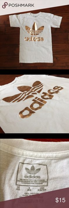 Adidas T-shirt Cute adidas t-shirt with brand logo in gold. Features logo on front, and mirror-image logo on back. Used, in good condition. Size XS. Adidas Tops Tees - Short Sleeve