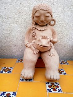 Girl with Frog ...by Probst Pottery