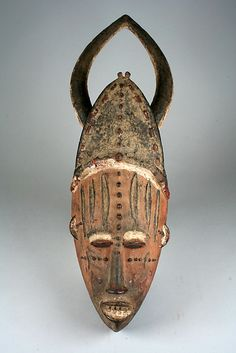 Africa | Horned Mask.  ca. 19th to 20th century | Nigeria, Niger Delta region, culture; Edo, Urhobo Group | Wood and pigments.
