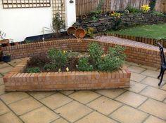 Brick raised flower bed design