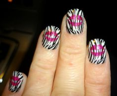 Zebra nails with pink lips.