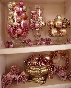 Love the christmas balls in glass vases:) Stunning:)