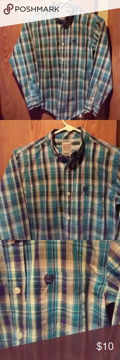 Cinch plaid western shirt   sz 10 Blue plaid western shirt. Sz 10. Long sleeve,  button up style. By Cinch. Excellent preowned condition. ..no rips or stains.  Smoker/pets in the home.  Do not purchase if this is an issue for you.  Questions and offers are welcome. Cinch Shirts & Tops Button Down Shirts
