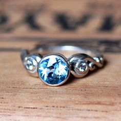 Hey, I found this really awesome Etsy listing at https://www.etsy.com/listing/152517304/3-stone-ring-blue-topaz-white-topaz
