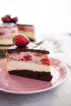 This Neapolitan Cheesecake is a triple threat! The classic ice cream flavor combo is perfectly transformed in this three-layer masterpiece of a dessert - chocolate brownie, creamy vanilla cheesecake, and fluffy strawberry cream topping, topped with a crown of chocolate ganache.