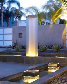 Water Studio.  Multiple water sculptures for a contemporary home. Glass, stainless steel frame, basalt.