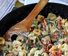 Tortellini with Creamy Sun-Dried Tomato Sauce and Spinach is a weeknight meal or a meal to impress guests! You'll love the flavor the sun-dried tomatoes add to the sauce!  Get the easy recipe on RachelCooks.com!
