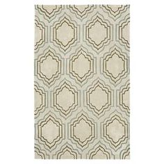 Hand-tufted beige rug with trellis motif.    Product: Rug Construction Material: Polyester Color: Beige and multi Features: Hand-tufted  Note: Please be aware that actual colors may vary from those shown on your screen. Accent rugs may also not show the entire pattern that the corresponding area rugs have. Cleaning and Care: Professional cleaning recommended