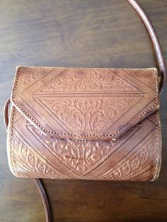 1970s Hippie Hand Tooled Leather Bag with by ReallySuperFunStuff, $25.00.  I love all the beautiful tooling on this.