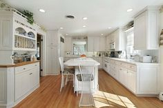 traditional white colors for small kitchens with wood floor