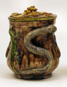 A Continental Palissey ware tobacco jar and cover moulded in relief with insects, snakes and lizards, 5.5ins high