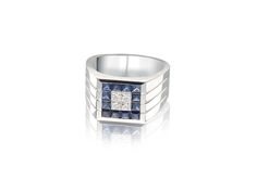 18K white gold ring with princess cut diamonds and sapphires.