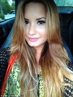 Demi Lovato with blonde hair.
