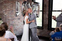 David's Bridal bride Rachel in cap sleeve long beaded sequin dress for her downtown Omaha wedding.