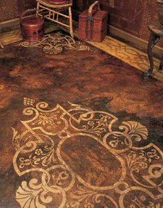 Elegantly stained & stenciled concrete floor...