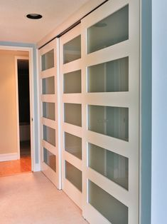 Gorgeous Interior Room Design With Delightful Rolling Closet Doors Ideas: Contemporary Interior Room Design With Lovely Rolling Closet Door Feats Charming Glass Elements And Excellent Glossy Laminated Flooring Ideas ~ bubaraba.com Apartment Inspiration
