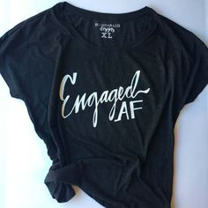 Engaged AF Flowy Tunic Shirt for the Newly. This is the perfect wedding planning top! It's vintage washed, which makes is super soft to the touch, and is available in several different colors. Order this for yourself or your bestie as a cute and fun engagement gift!