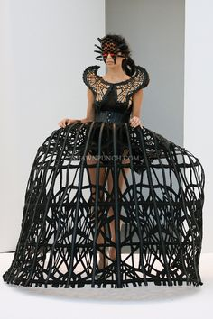 HER SKIRT REMINDS ME OF THUNDER DOME. WOULD YOU LET YOUR DAUGHTER WEAR THIS TO A BALL AT THE HOTEL CRILLON ?