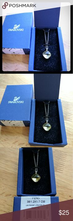 """Swarovski Lea Pendant Swarovski Lea Pendant. Worn only a few times. 15"""" chain. Light green in color. Swarovski Jewelry Necklaces"""