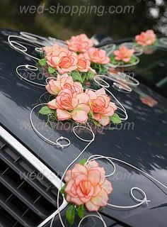 Kit consists of:  24 flowers with leaves  12 rattan twigs decorated with pearls  You are free to arrange the decoration.  Ornament completely safe for car paint