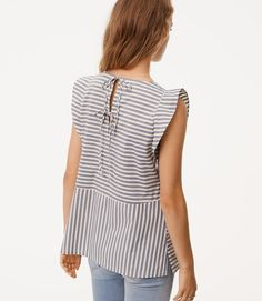 cb192bd4d49a  44.50 A double tie back turns up the flirt of this fluttery top Minimal  Classic Style