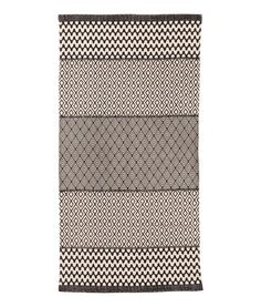 Natural white/charcoal gray. Rectangular rug in woven cotton fabric with a printed pattern at front.