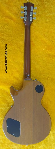 The Mahogany wood grain on the back of a Fernandes Super Grade Gold Top