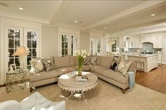 A great way to decorate an open layout, separating the two rooms but still having  good flow theoughout