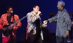 Nelson Mandela, right, with South African singer Johnny Clegg during a concert… Nelson Mandela, Songs About Hope, Zulu Dance, Political Songs, Aids Awareness, Joan Baez, Song Playlist, Dance Fashion, Bob Dylan