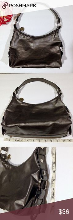 TOMMY HILFIGER Metallic Gunmetal Gray Hobo Handbag Tommy Hilfiger hobo bag in metallic gray silver tone. Shiny, metallic shoulder bag / purse / handbag. Gunmetal gray, closest to color shown in pic 6. Lots of storage / organization spaces, pockets. Logo embossed silver tone metalwork. Used condition, carefully inspected for quality assurance. Pictures show any wear / issues. Exterior in great condition! Interior very good. Tommy Hilfiger Bags Hobos