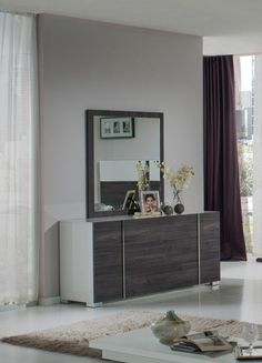 "Nova Domus Corrado Italian Modern Grey Mirror. The Nova Domus Corrado Italian Modern White & Grey Mirror in smooth white gloss finish measures W39"" x D1"" x H41"" adds glamour and is fitting in any living space. The dresser in the photo is available separately. Dimensions: W39"" x D1"" x H41"" Color: White Finish:  Glossy -"