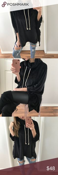 """Black Magical Pull-Over Sweater It is the softest thing I've ever felt. You'll want to cozy up and never leave the house! Has a loose open fit, dolman style, side slits, a small half turtleneck that can fold and tighten with adjustable strings. Very easy to place it wear you want. This looks great with leggings or denim. Previously sold out in oatmeal   Modeling:  S Measures: 27"""" L • body is very open  Size Difference: 1"""" bigger all over  Fabric: 100% Poly   Please use the """"Self Checkout or…"""