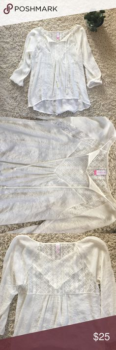 Cream Peasant Blouse NWOT. Never worn. Only tried on. Size L. But can fit a Medium and still be flattering. Tassels on front. Tribal print lace on front and back. Hits below the belt loops. Very breathable & soft. 3/4 sleeve with elastic cuffs. No snags or stains. OFFERS WELCOMED. No Boundaries Tops Blouses