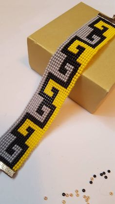 Bright yellow, grey and white bead loom bracelet. Adjustable lenght 17 cm – 20 cm Bright yellow, grey and white bead loom bracelet. Loom Bracelet Patterns, Bead Loom Bracelets, Bead Loom Patterns, Beaded Jewelry Patterns, Beading Patterns, Beading Ideas, Beading Supplies, Loom Bands, Motifs Perler