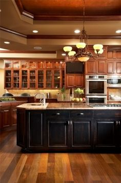 black base cabinets and oak wall cabinets and floors