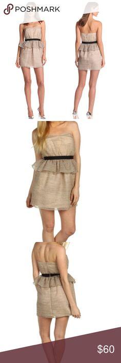 "BCBGeneration Beige Peplum Tube Dress NWT. Stunning strapless dress in Beige. Shimmering Metallic embroidery lends the lightweight organza a subtle allover stripe. Sweetheart neckline, Peplum detail at banded empire waist. Straight hem, hidden back Zip closure. Fully lined. 50% polyester/49% Nylon/1% metallic. Length 27"". Size 4. No modeling/trades. BCBGeneration Dresses Strapless"