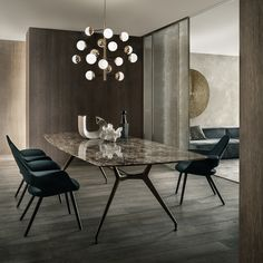 #Rimadesio Manta table with brown aluminum structure and emperador marble top. Velaria sliding doors in palladio aluminum and golden mesh glass.