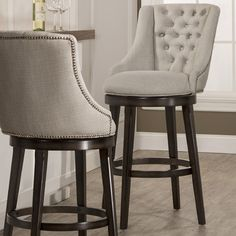 Features: -360 degree swivel stool. -Armchair design. -Nailhead trim on the back. -Halbrooke collection. -Counter Height: Yes. Frame Material: -Wood. Frame Finish: -Smoke. Seat Material: -Fabr