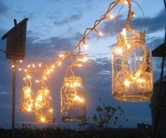 Whoever thought of this get's a gold star... some twine, lots of white lights and mason jars... Why didn't I think of this?!?!? The best Summer evening ever!