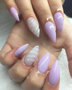 Unicorn horn nails are the biggest manicure trend of 2017. This lavender manicure is the perfect shade for spring.