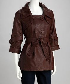 Feel great flaunting a faux leather jacket. Reminiscent of a trench, this piece features a tie at the waist, double-breasted buttons and cropped sleeves for extra flair. Includes jacket and beltMeasurements (size S): 29'' long from high point of shoulder to hemShell: 55% polyurethane / 45% viscose