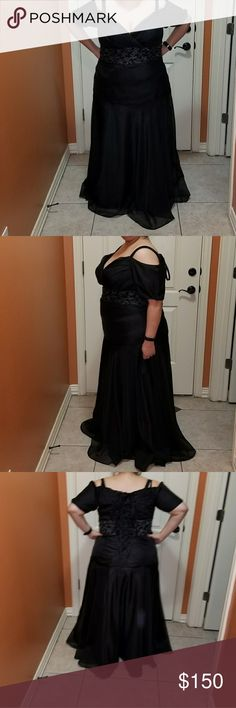 Black formal gown 2X or size 20 This gown was worn once. It was custom made for me. Fully lined. The laces in the back make it easy to mold it to your own curves. This dress can easily go to a size 22 or a size 18 because of the lace corset type. For reference I am 5'6 and weigh 240 and that's me wearing the dress. I had it custom made to accentuate the good and hide my flaws (I hate my arms lol). Let me know if you have any questions Dresses Prom