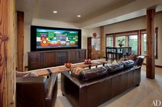 The Trilogy Partners–designed media room of South Park cocreator Trey Parker's hilltop retreat in Steamboat Springs, Colorado, includes a tansu-style credenza.