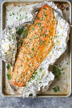 Garlic Butter Salmon in Foil - Damn Delicious Garlic Butter Salmon in Foil - Easiest tin foil dinner! Simply bake right in your foil packet. Quick, easy, and effortless with seriously zero clean-up! Salmon In Foil Recipes, Fish Recipes, Seafood Recipes, Cooking Recipes, Healthy Recipes, Salmon Foil, Damn Delicious Recipes, Wildly Delicious, Best Salmon Recipe