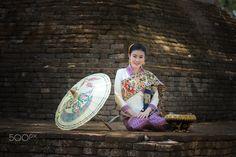 Beautiful woman in Thai traditional costume. - Beautiful woman in Thai traditional costume.