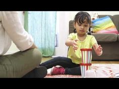 Show your child how fun it can be to build and knock down cup towers - while helping her become a learner for life.