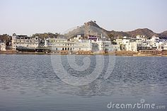 Photo about A view of the city of ancient Pushkar Rajasthan with its ancient lake in front. Image of catchment, oasis, city - 70658225 Royalty Free Stock Photos, India, City, Image, Delhi India, City Drawing, Cities